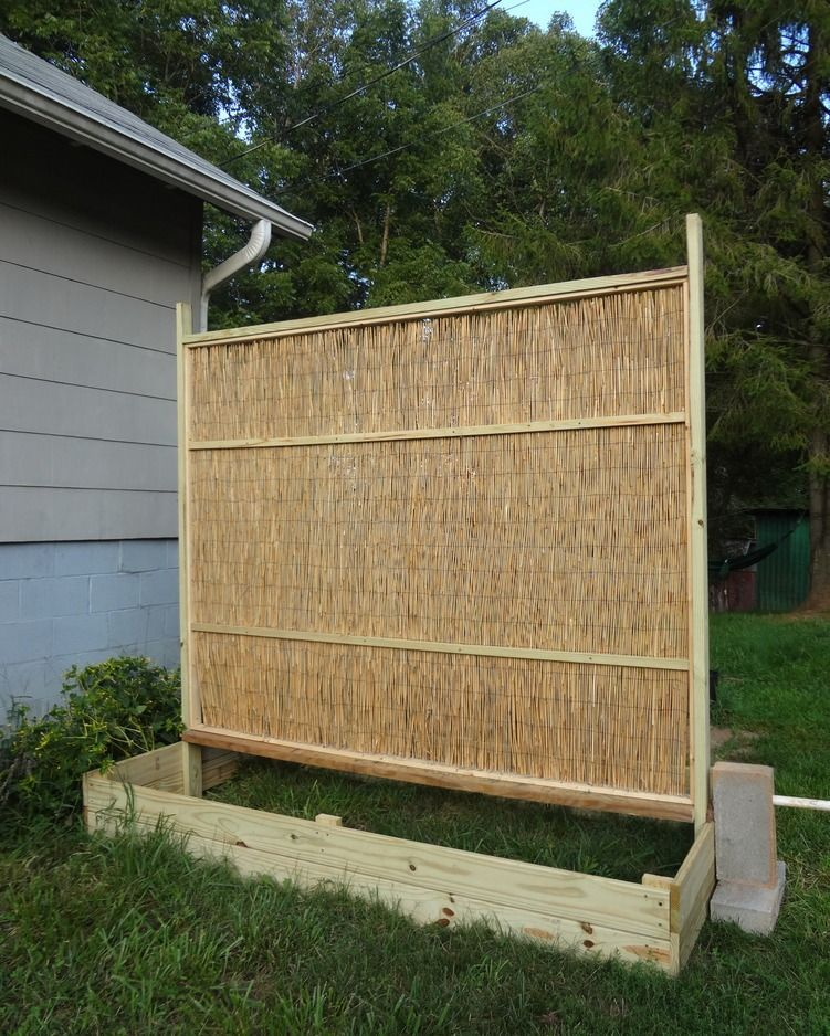 Eric designed and built this raised bed/fence panel for