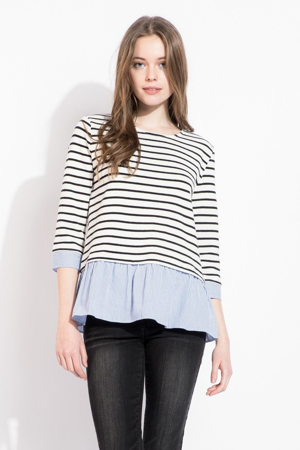 bd85c38748d Classic black and white stripes with a light blue peplum accent makes this  blouse so easy to wear! Great casual chic top for layering.