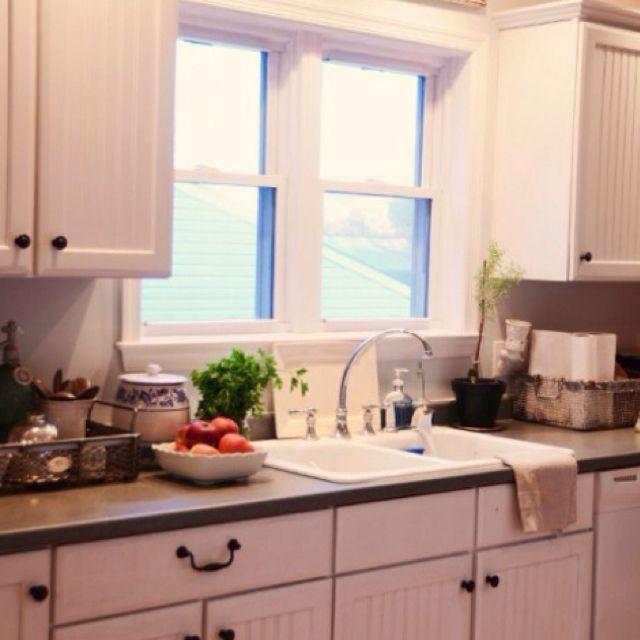 White cabinets, dark counter top