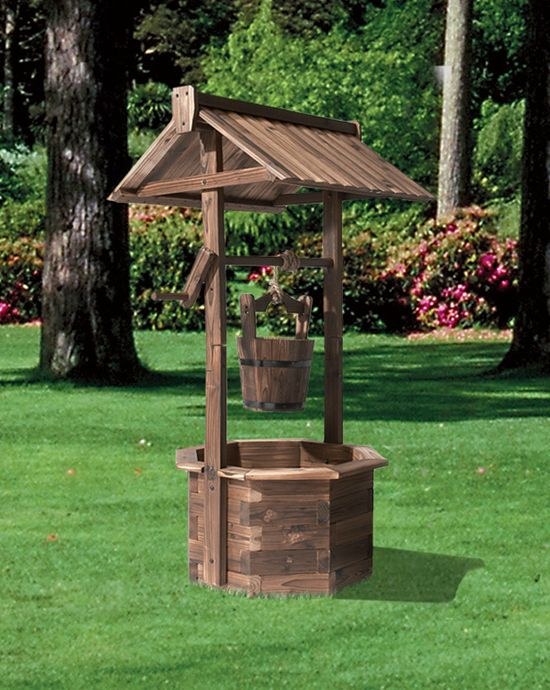 Add a rustic touch to your garden with this wishing well for Garden wishing well designs