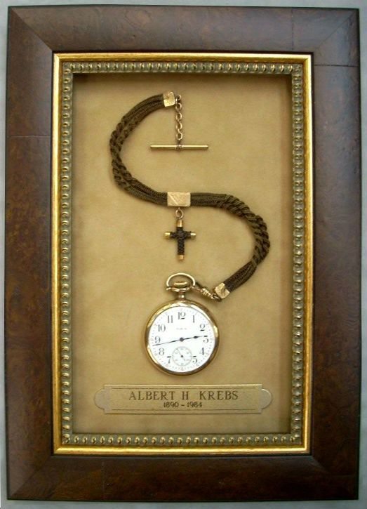 A nice way to display an old pocket watch... http://www.artshopnc.com/large-website-images/pocket-watch-large.html