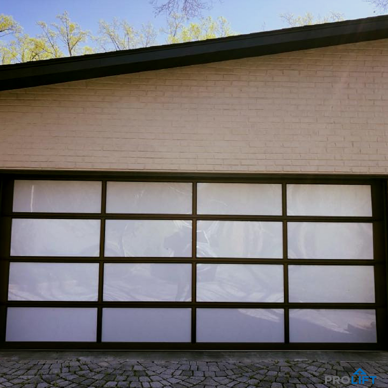 For A Modern Garage Door Consider A Style Like This Bronze Anodized Aluminum Frame With White Acrylic Panels Modern Garage Doors Garage Design Modern Garage
