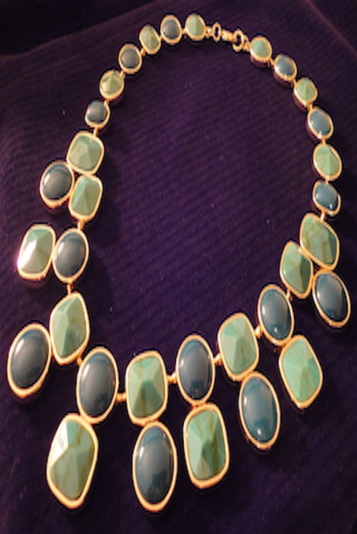 Both bold and refined, this regal teal necklace makes the perfect statement.