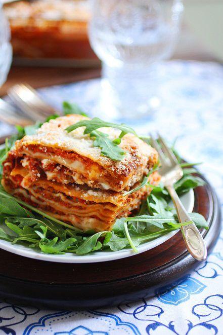 Authentic Baked Lasagna made with bolognese sauce, bechamel, fontina, mozzerella di Bufala, and Parmigiano