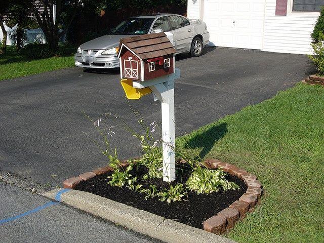 landscaping around mailbox soil with brick around