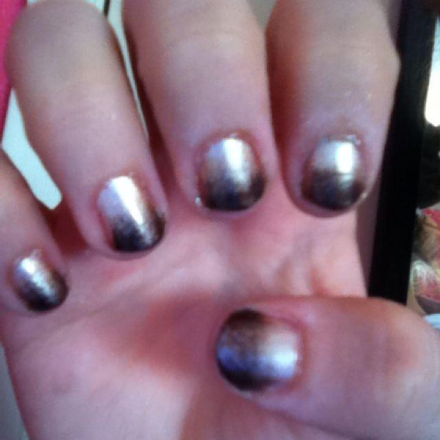 Brown ombré nails.