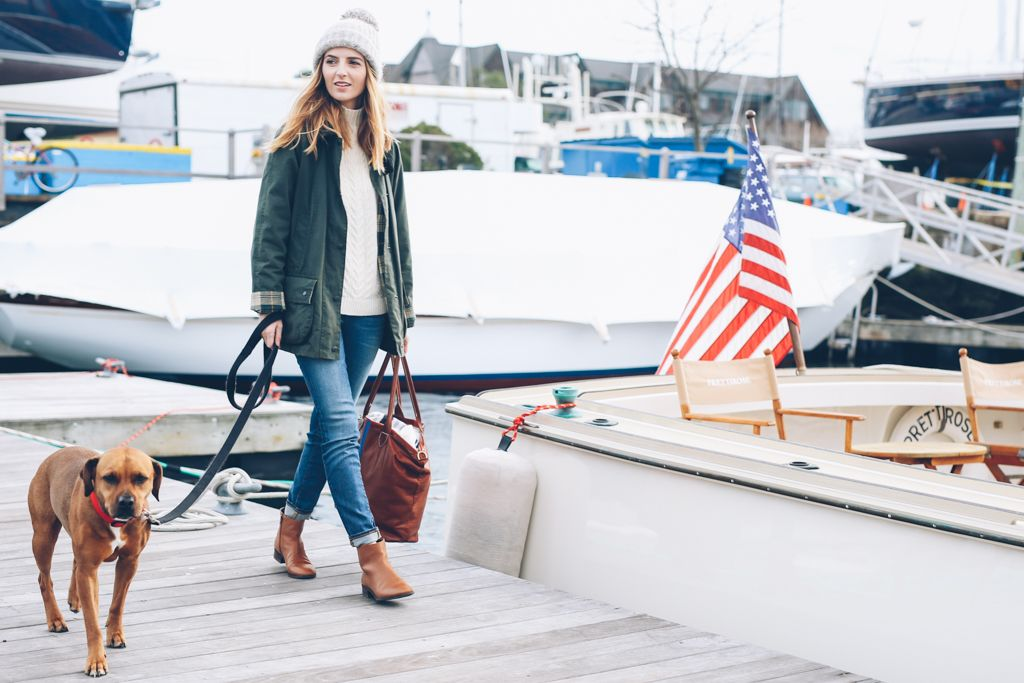 New England winter style on the docks in a barbour jacket and ankle boots.
