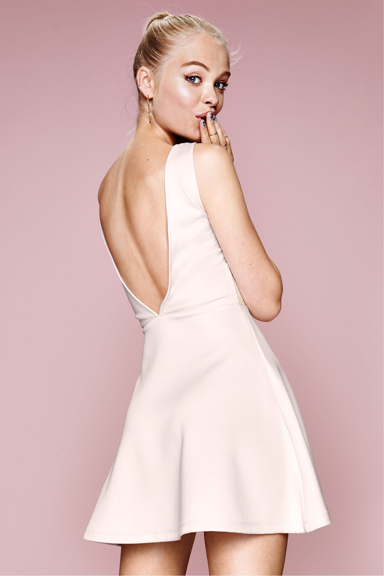 Light pink short, flared dress with lace details & low-cut V-neck ...