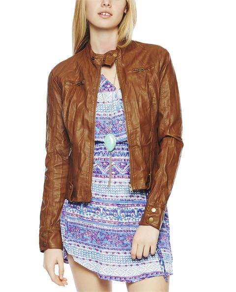 "Top your outfit with this fitted jacket featuring a crinkle faux leather body, zip up front and pockets, snap button hem, neck, and sleeves.  Jacket is fully lined.   Model is 5'9"" and wears a size small      Body: 100% Polyurethane - Lining: 100% Polyester     Hand Wash     Imported"
