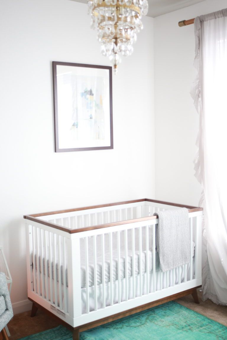 Loving this whimsical boho nursery... and that touch of glam in the vintage light fixture? YES.