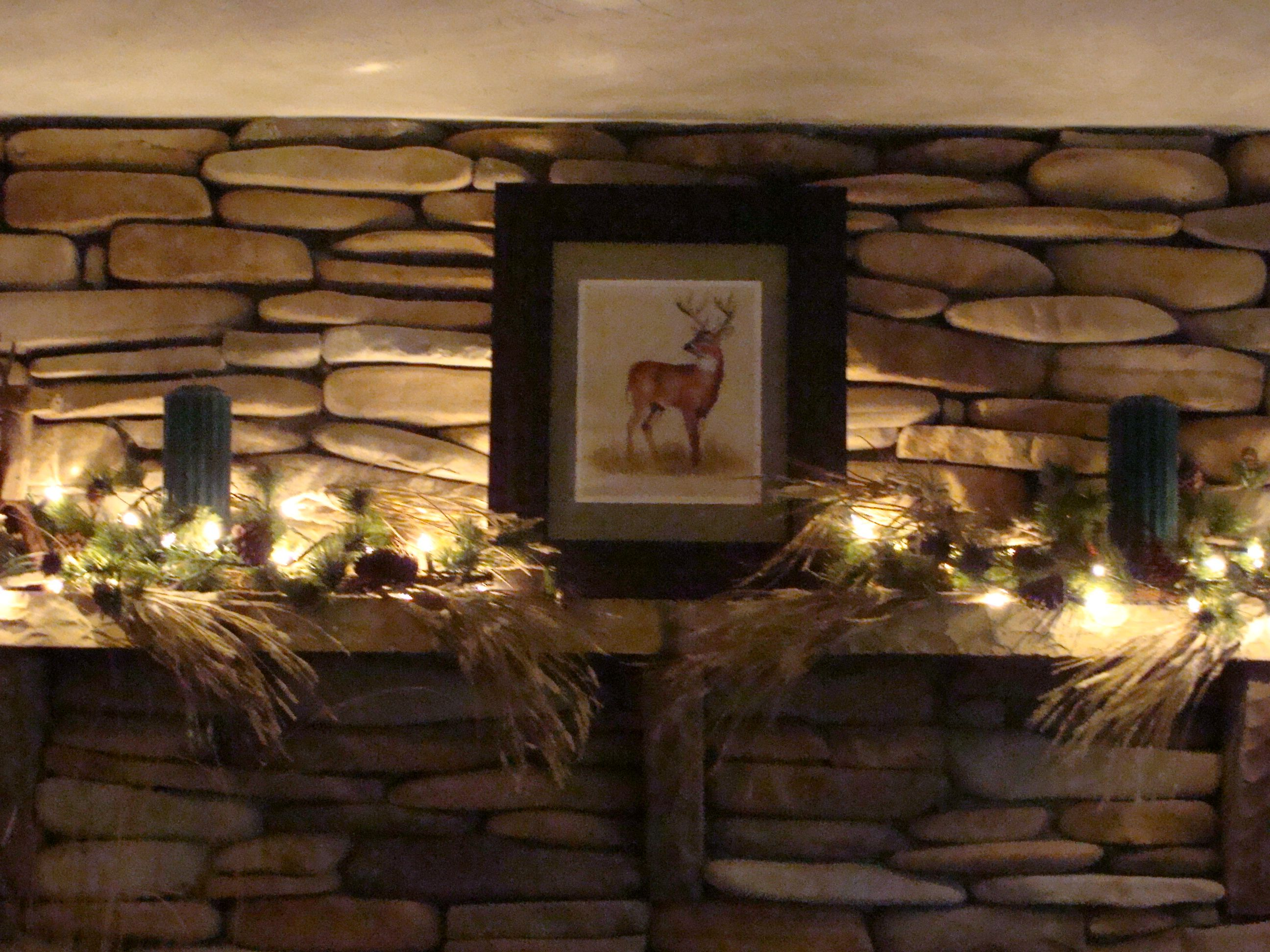 i love christmas lights year round for dim lighting used here with greenery on a mantle