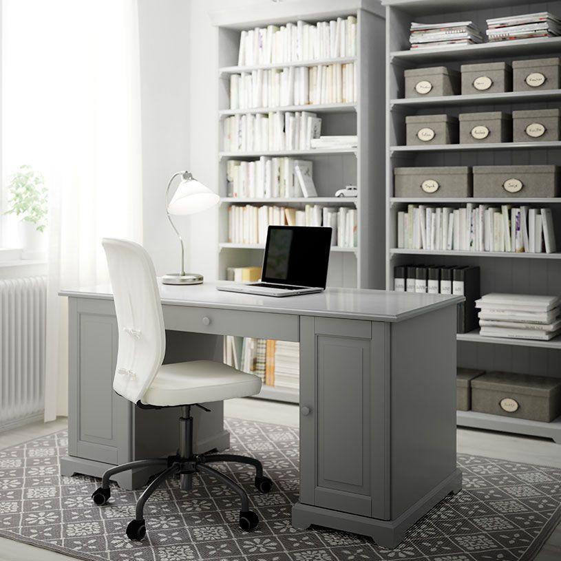 bureau domicile avec bureau et biblioth ques en gris et chaise pivotante avec rev tement en. Black Bedroom Furniture Sets. Home Design Ideas