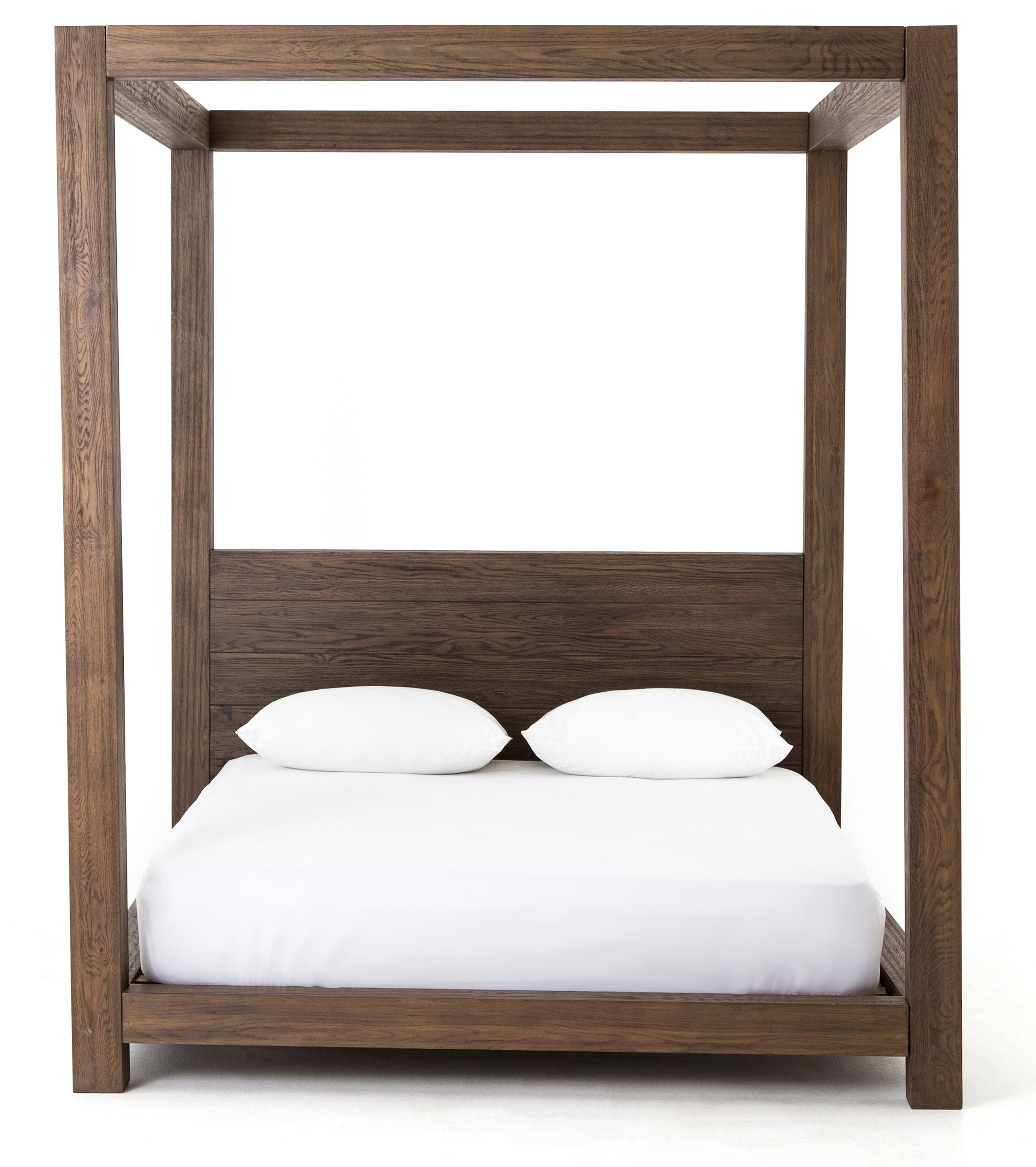 A Simple Four Poster Canopy Bedframe In Solid Oak Makes An Elegant