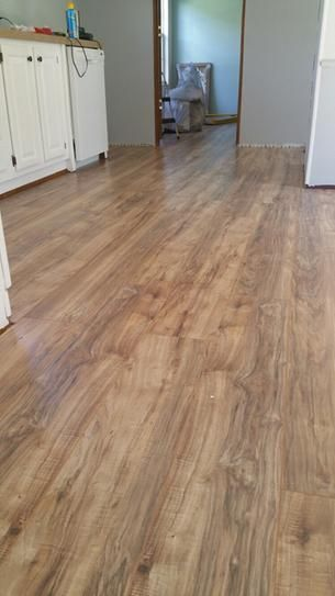 Trafficmaster Lakeshore Pecan 7 Mm Thick X 7 2 3 In Wide X 50 5 8 In Length Laminate Floor Vinyl Wood Flooring Laminate Flooring Waterproof Laminate Flooring