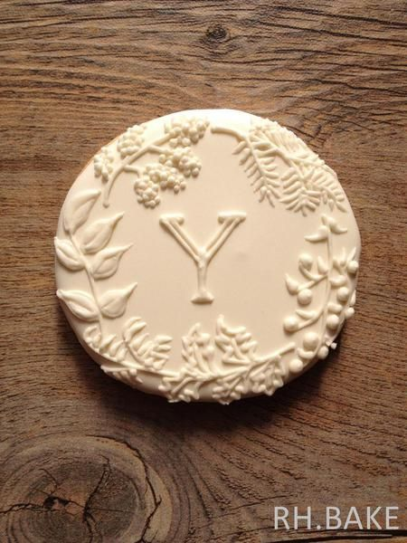 Botanical white on white initial cookie