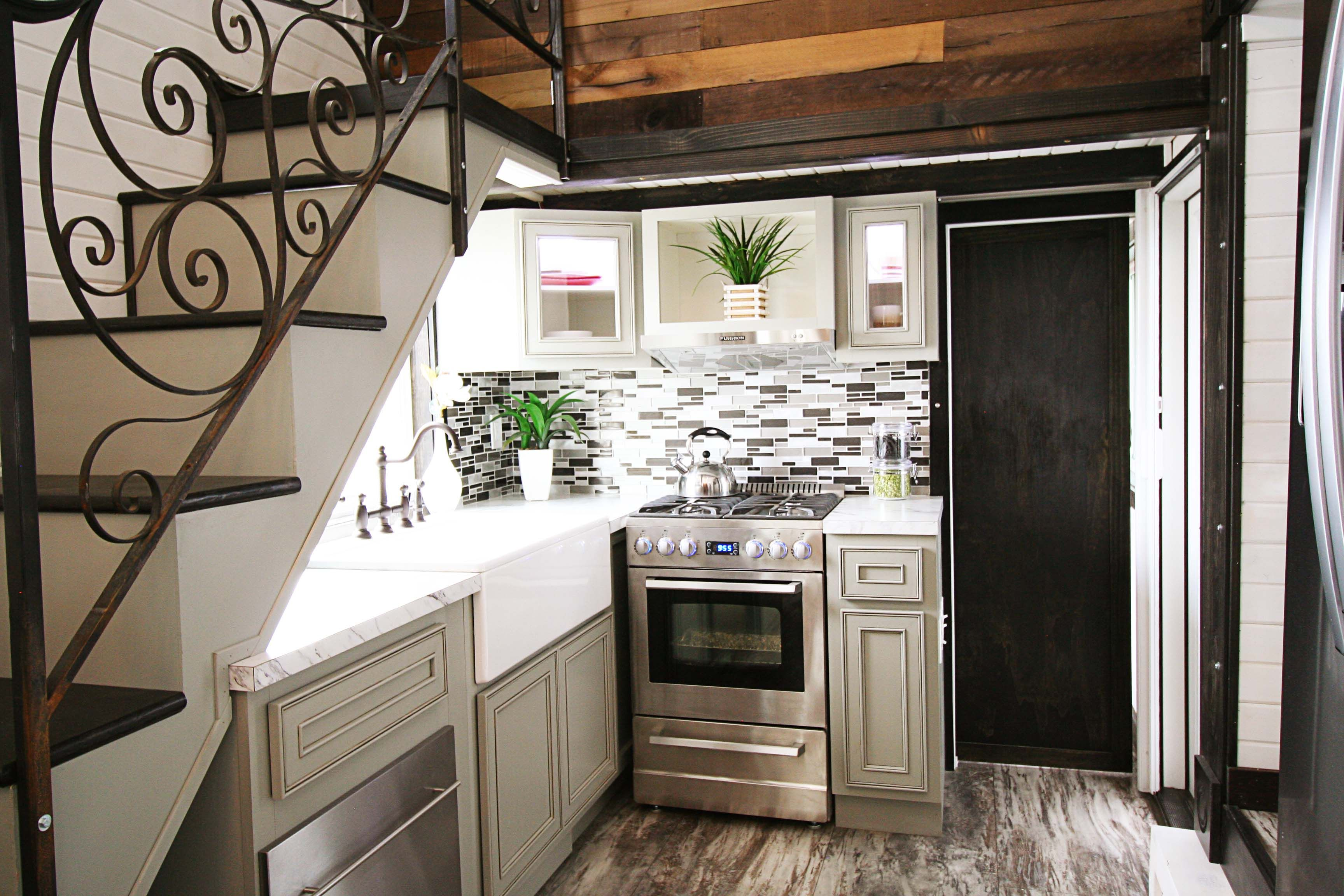 The Kitchen Features Wilsonart Calcutta Marble Laminate Counter Tops A Metal Glass Title Tiny House Kitchen Small Apartment Kitchen Small Outdoor Kitchens