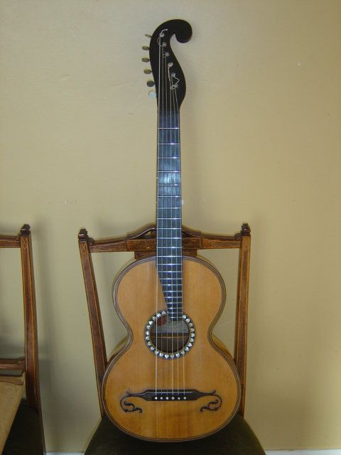 1830 Stauffer Terz guitar. smaller & tuned a minor third higher than the regular guitar of the day. 22 frets. Guiliani wrote a concerto for terz guitar.