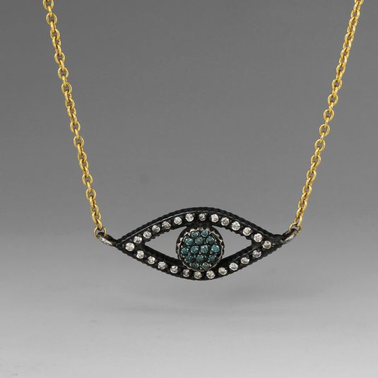 An 18k yellow gold and gilver necklace with an eye with pave white and teal diamonds=  0.40cttw. Made By Yossi Harari.