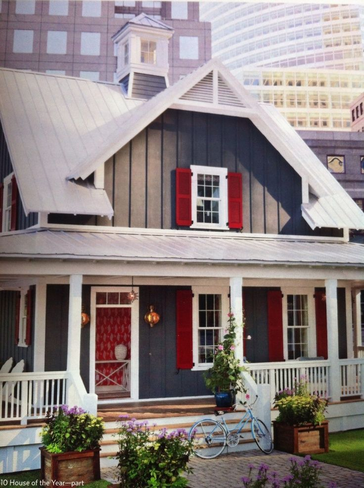 Gray batten board siding white trim and red shutters for What is the best siding for a house