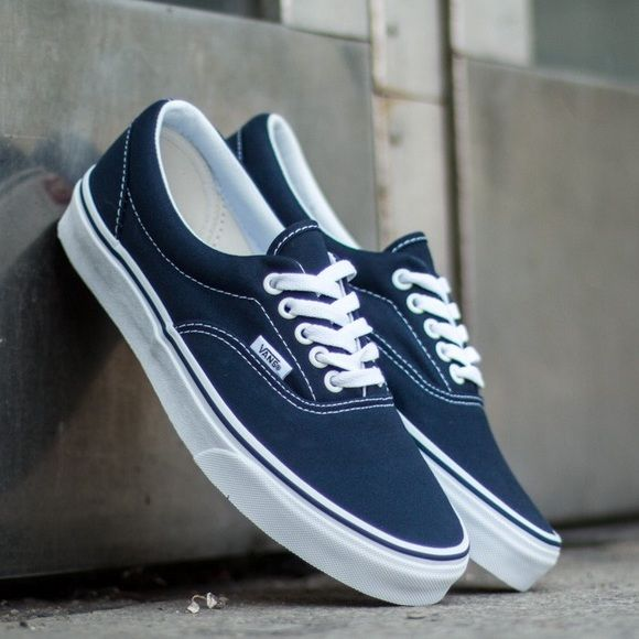 Vans Era Navy Canvas Sneaker Classic Vans Era canvas sneaker in navy.  Excellent summer shoe that is both comfortable and versatile. 9bc08145d6