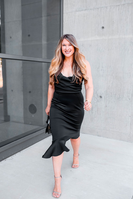 Slinky black dress with silver stuart weitzman sandals date night