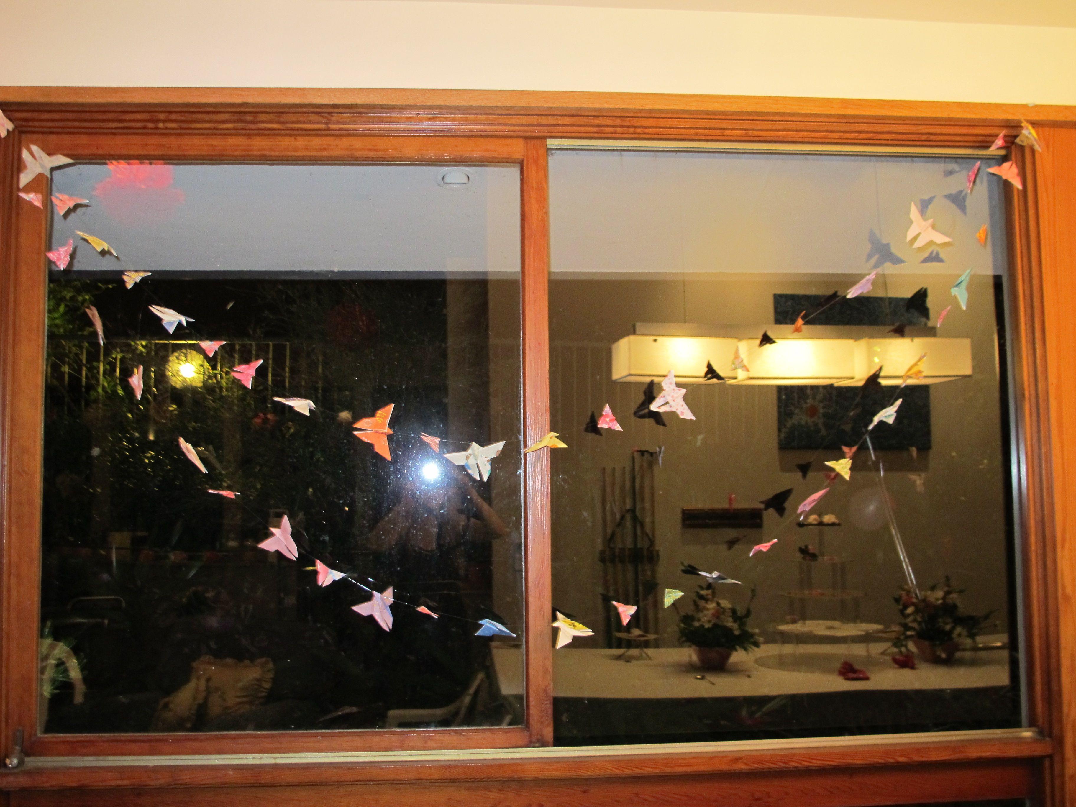 strings of origami butterflies on fishing line