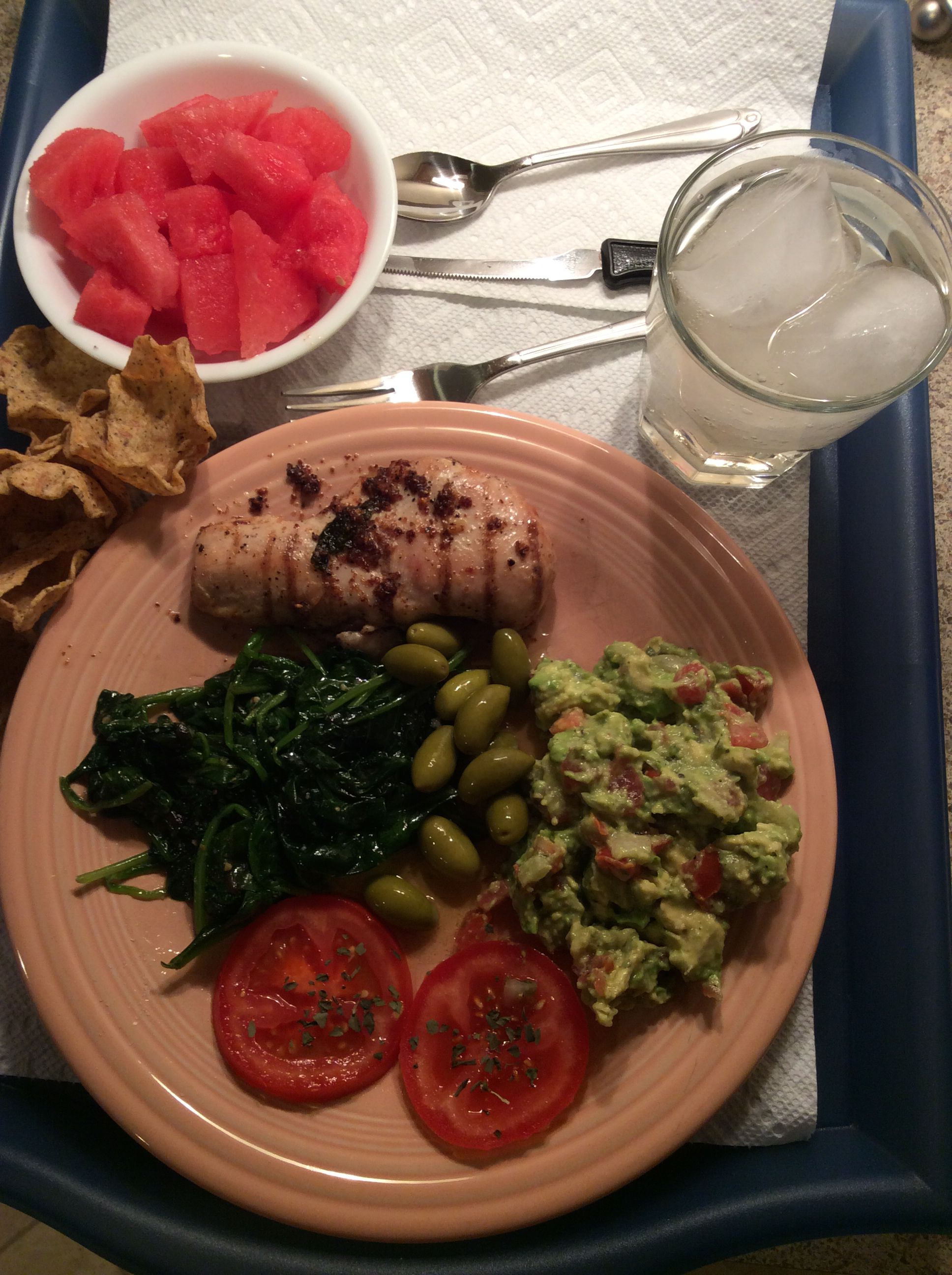 Trader Joes free range chicken made lemon pepper style with guacamole & sautéed spinach.
