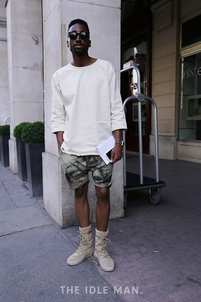 Men's Street Style at Paris Men's Fashion Week | Camo King - When going for a camo look, it's best to keep it simple. Avoid clashing prints and stick to a basic sweater and Desert boots. | Shop the look at The Idle Man