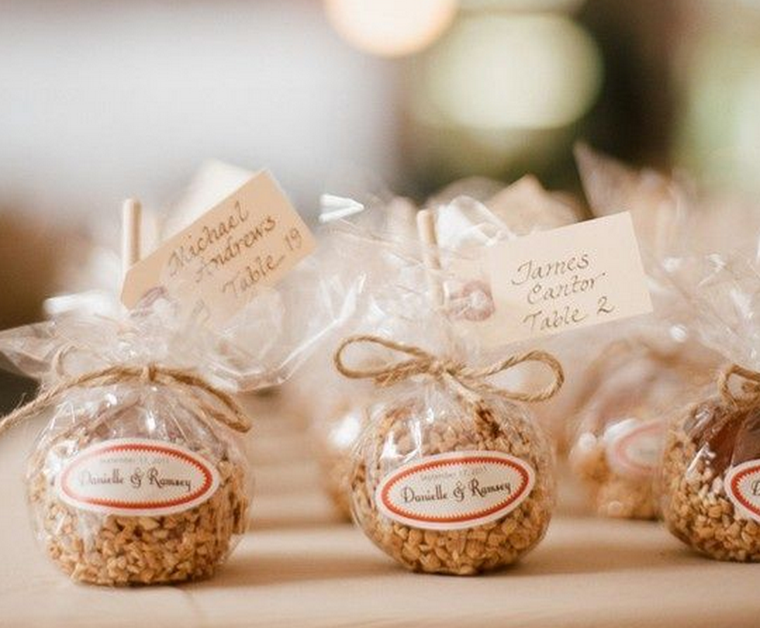 Wedding party favors add to the decor and theme of the reception, ranging from simple bookmarkers to elegant crystal or silver pieces for the bridal party that can later be displayed in a curio cabinet or on a fireplace mantle.