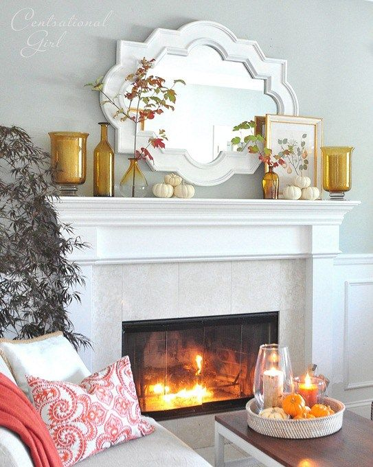 ideas on how to decorate a mantel using a mirror on a white mantel with gold accents