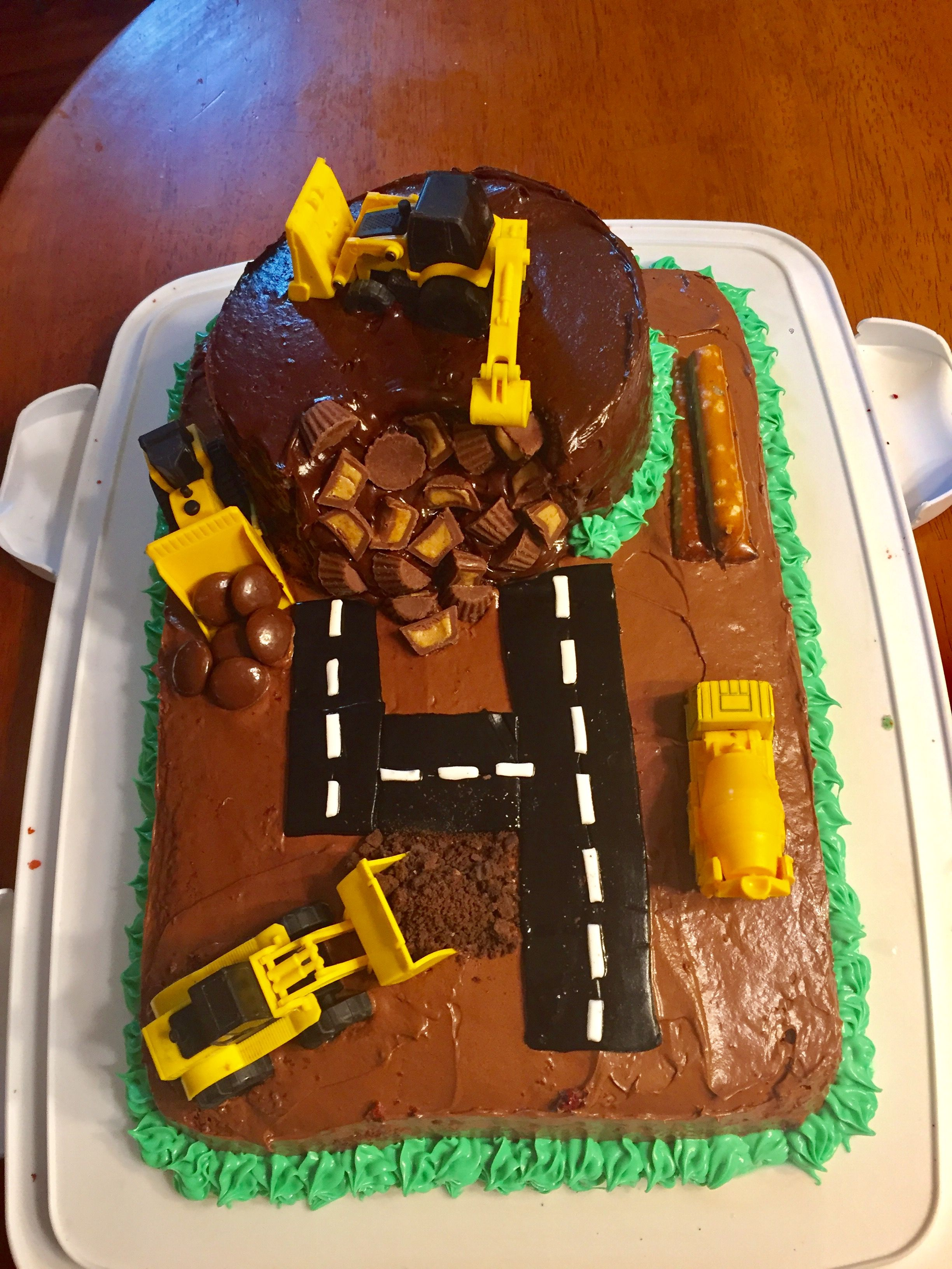 Construction birthday cake with sheet cake and 6 round