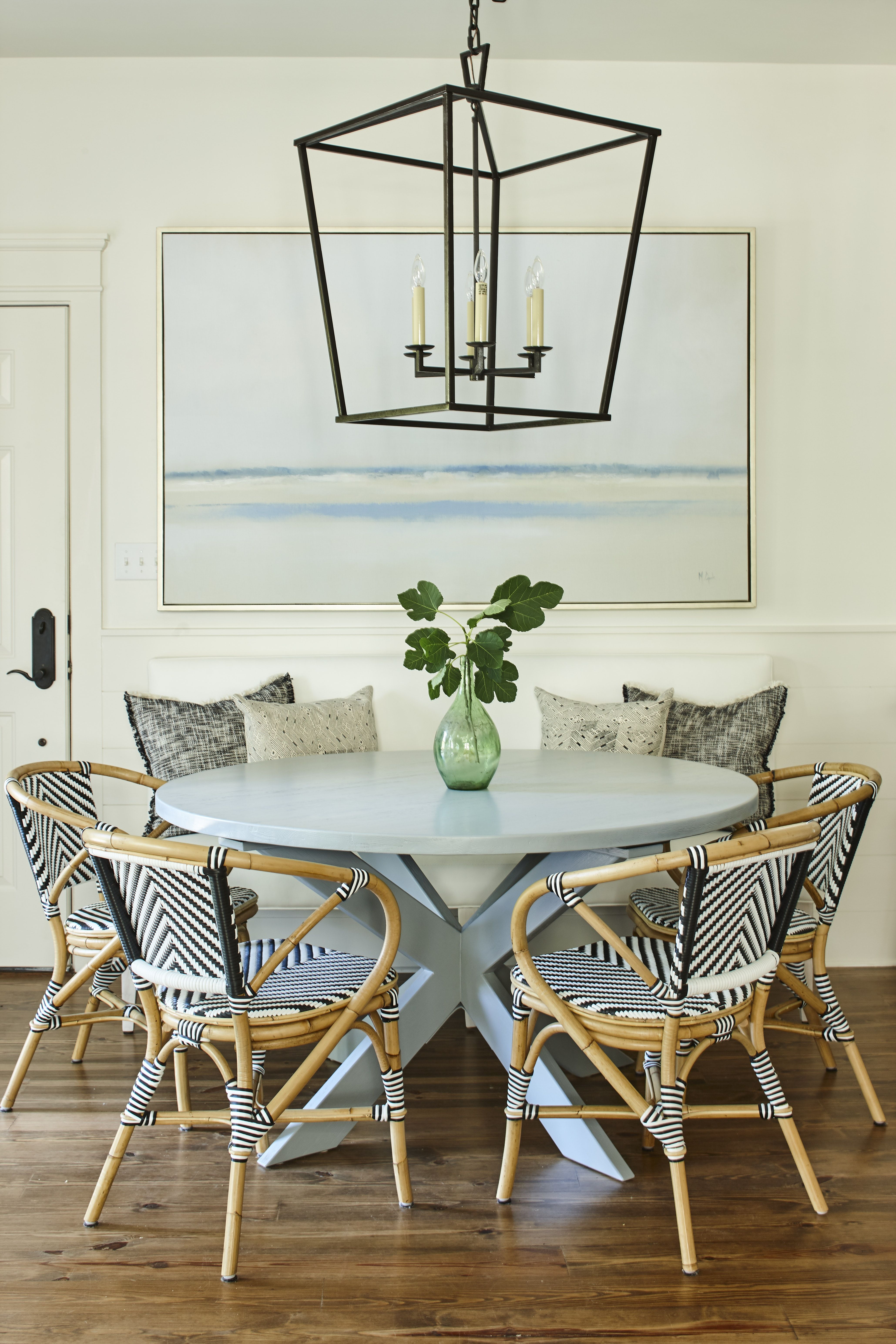 dining area with french bistro chairs and large pendant  French