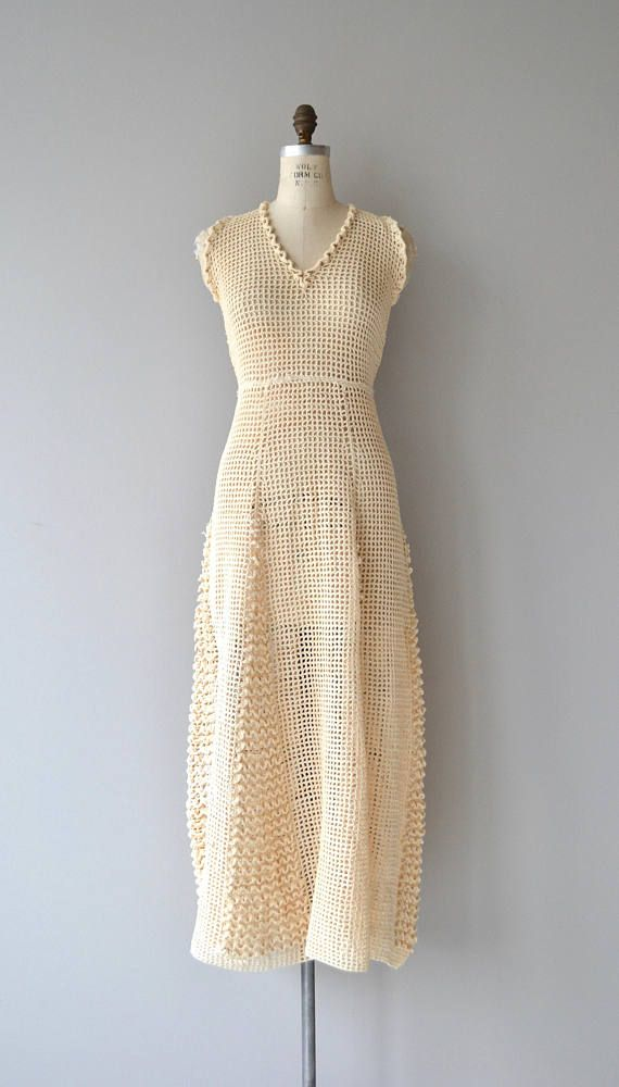Vintage 1970s cream crochet maxi dress with sleeveless bodice, V neckline, slightly elevated waist and no closures, slip on easily over the head. --- M E A S U R E M E N T S --- fits like: medium bust: 36-39 waist: 32-36 hip: 41-46 length: 56 brand/maker: n/a condition: excellent to ensure a good fit, please read the sizing guide: http://www.etsy.com/shop/DearGolden/policy ✩ layaway is available for this item ✩ more vintage dresses ✩ http://ww...