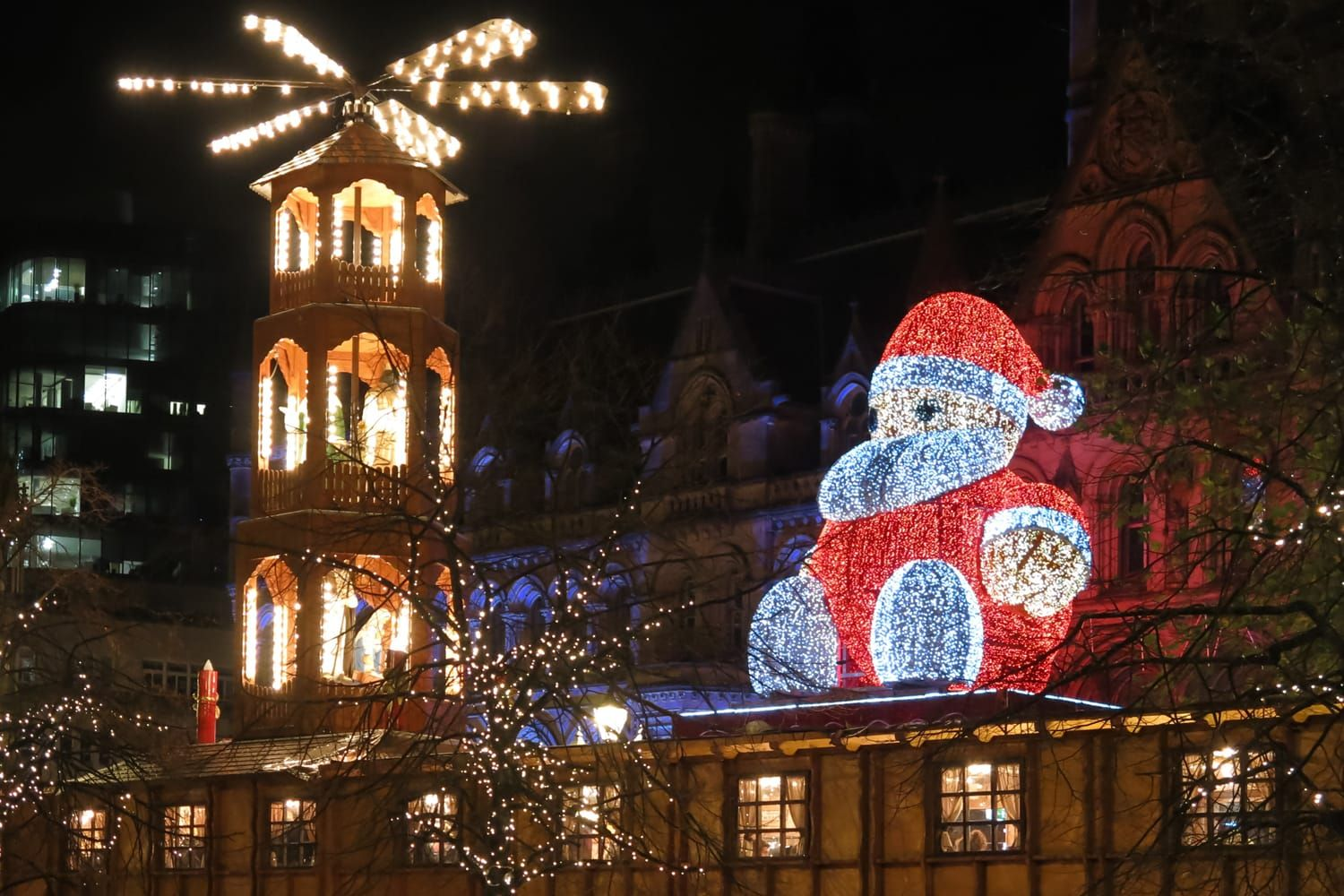Santa Claus On Christmas Market And Town Hall On Albert Square In Manchester At Night Christmas Markets Europe Best Christmas Markets Christmas Market