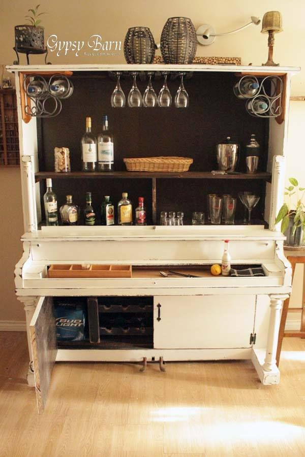 So cool!! An old piano repurposed as a bar. I think I will