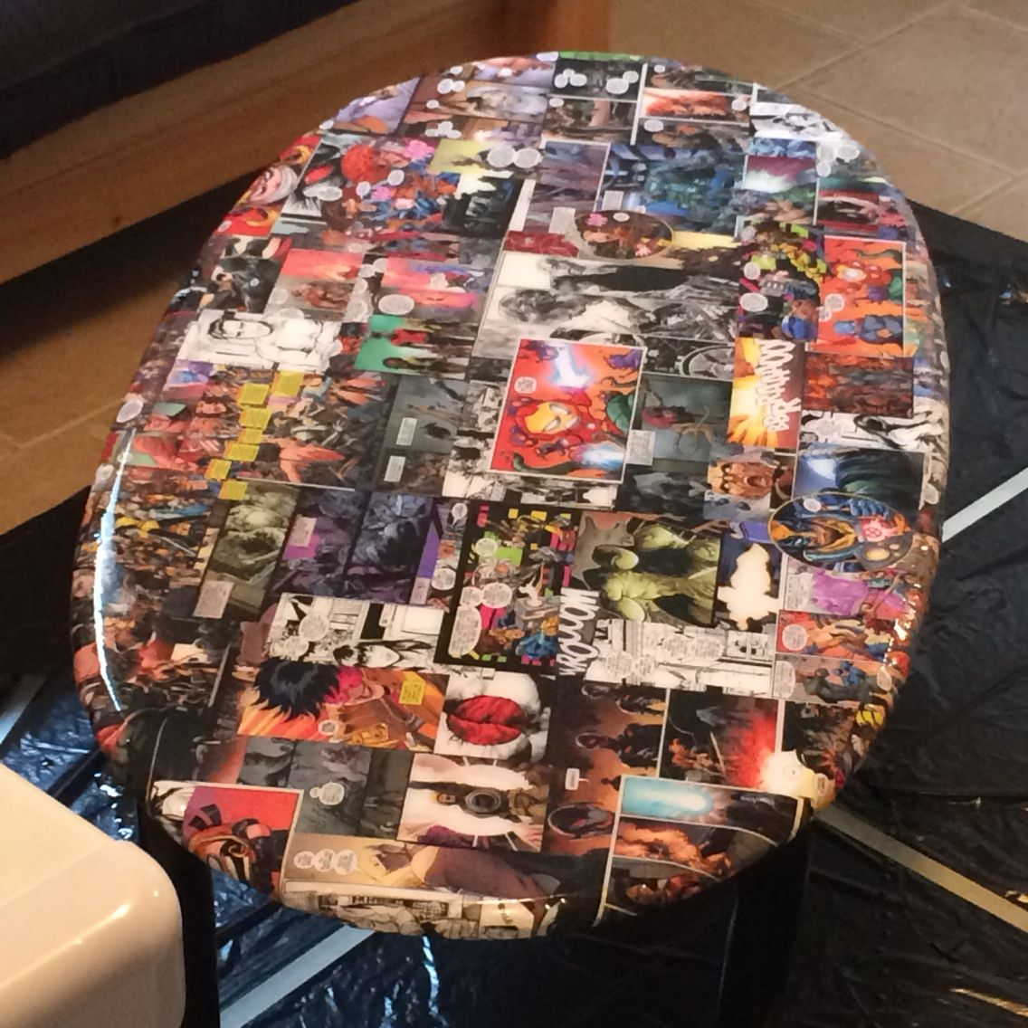Upcycled old table into new comic book themed coffee table