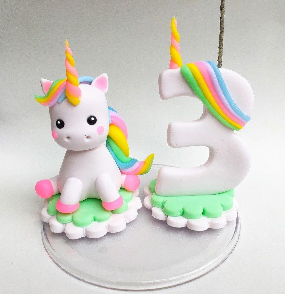 Topinho de bolo tema Unicórnio,com vela decorada em biscuit