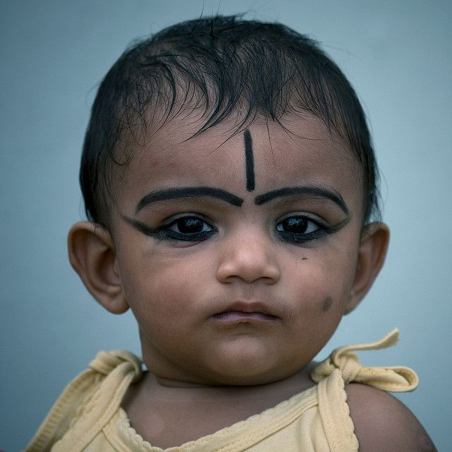 Baby with make up, India    The make up is made to protect the baby from the devils and the bad things around him. Almost all the babies wear this kind of make up