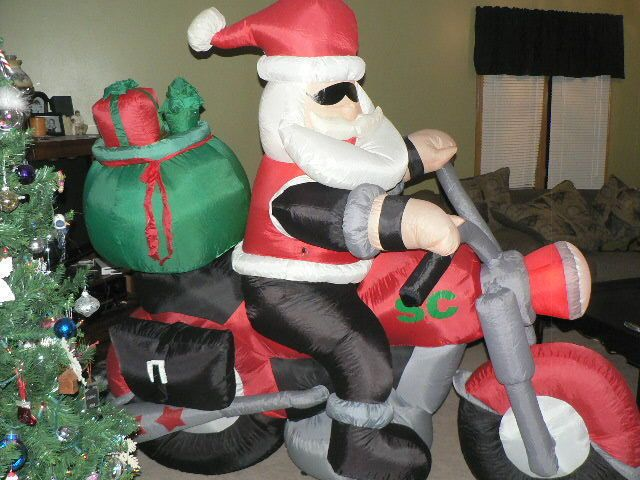 Gemmy airblown inflatable ft long santa claus on