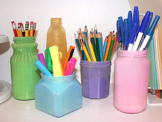 Painting jars to make colorful containers -- she uses for art supply storage but could be used for other things too.  From One Good Thing.