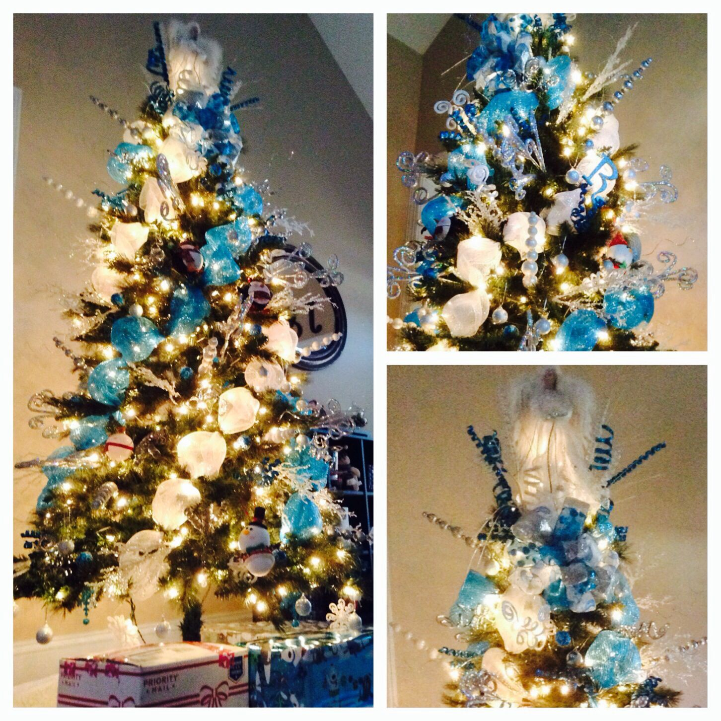 Whimsical blue silver and white themed christmas tree With angel