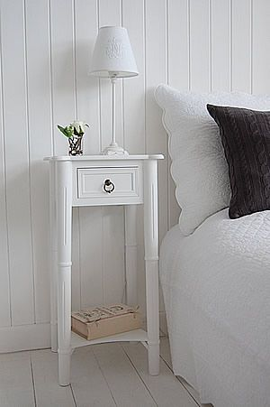 Tall, narrow bedside table to go with tall bed. New England white bedside  table