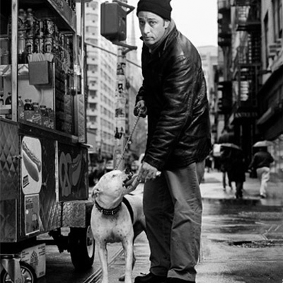 Jon Stewart feeding a hot dog to a pit bull :)