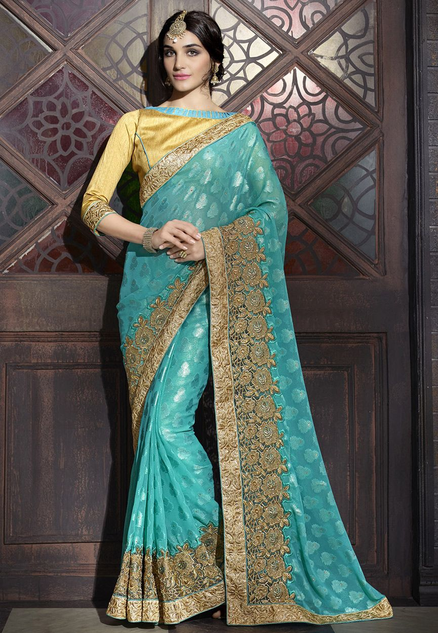 Net saree images buy turquoise faux georgette brasso and net saree with blouse online