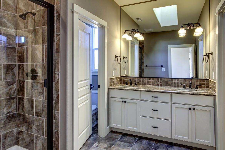 Neutral bathroom, granite countertops, giant mirror, beautiful tile ...