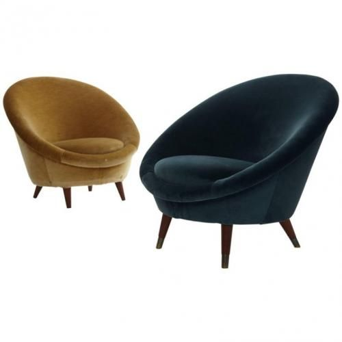 this is a pair of 1950s norwegian egg chairs upholstered in velvet