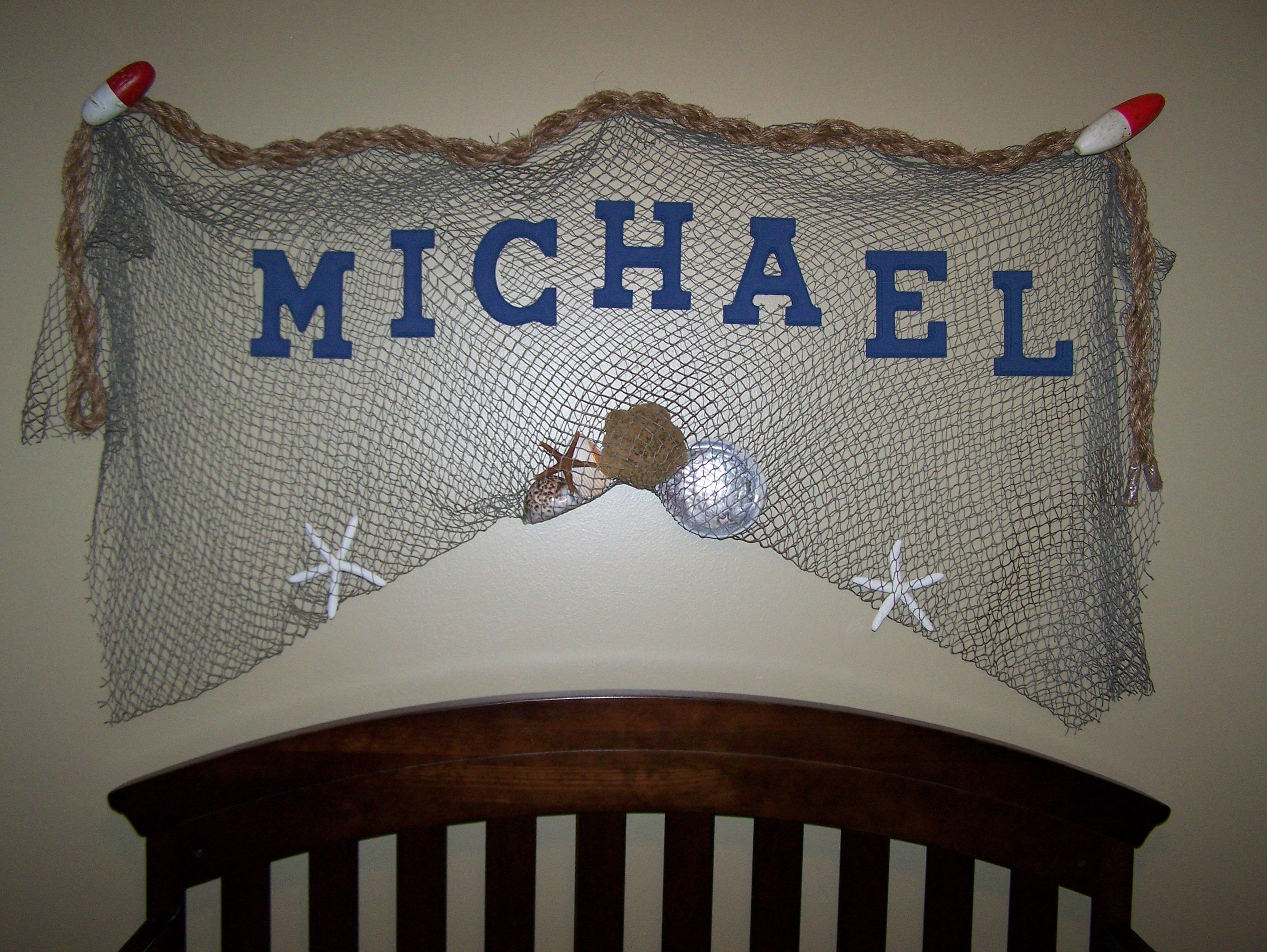 Adding to the nautical theme decorative fish net with for Cheap nautical decorating ideas