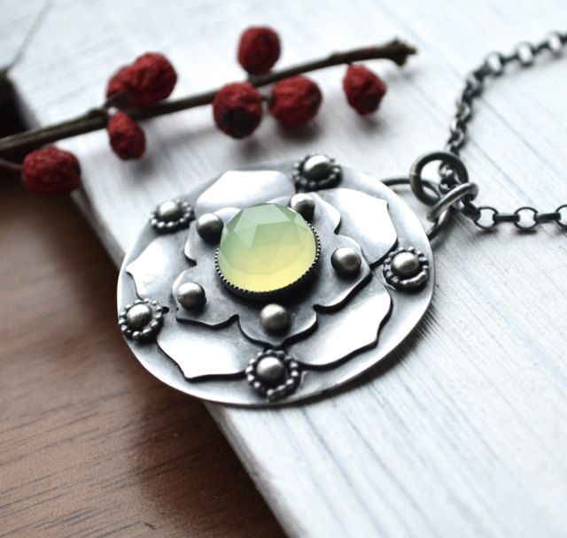 Lotus Leaf Pendant Necklace Handmade Metalwork in Sterling Silver and Chalcedony. $164.00, via Etsy.