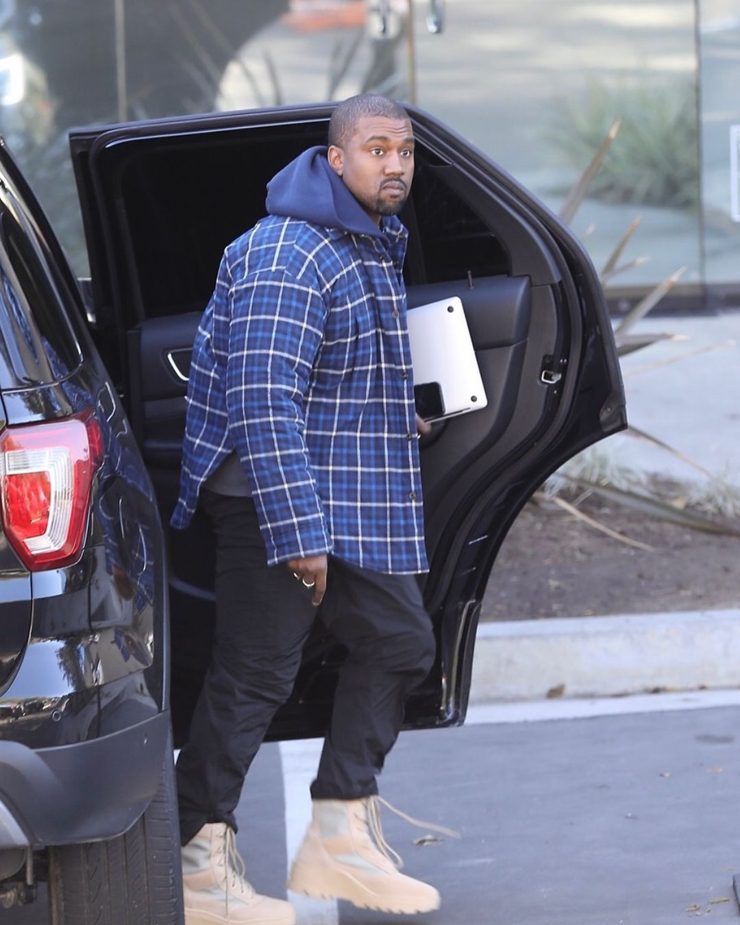 Kanye West S Best Winter Looks Where To Buy Them Kanye West Style Kanye West Style Outfits Kanye West Outfits