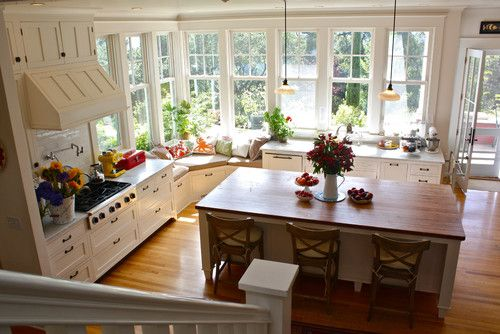 Love all the windows and cheerful/cozy window seat.    traditional kitchen by Shannon Malone